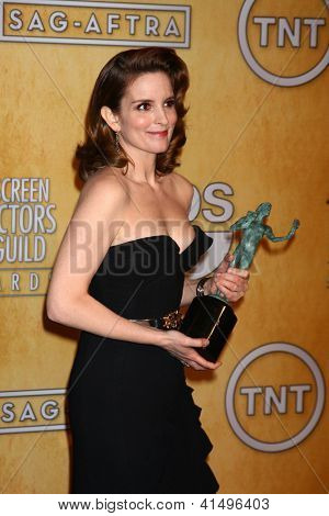 LOS ANGELES - JAN 27:  Tina Fey pose in the press room at the 2013 Screen Actor's Guild Awards at the Shrine Auditorium on January 27, 2013 in Los Angeles, CA