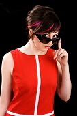 picture of ironic  - Ironic sexy woman in sunglasses on black background - JPG