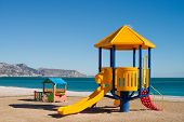picture of chute  - A colorful chute on a sunny Mediterranean beach - JPG