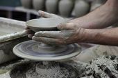 Potter's Hands Working On Clay Bowl.