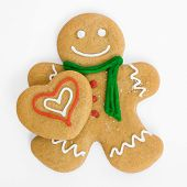 foto of gingerbread man  - Smiling gingerbread man holds iced gingerbread heart - JPG