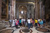ROME - JUNE 22: Crowd of tourists Indoor St. Peter's Basilica on June 22, 2012 in Rome, Italy. St. P