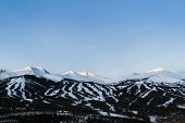 stock photo of landforms  - Breckenridge ski area at sunrise in the winter.