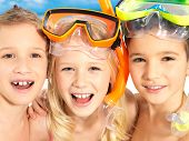 foto of suntanning  - Portrait of the happy children enjoying at beach - JPG