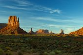 picture of sagebrush  - View of famous Monument Valley with Left Mitten on left and other rock formations with sagebrush dotting the foreground - JPG