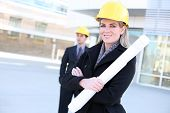 foto of hard_hat  - An attractive business team working construction on the building site - JPG