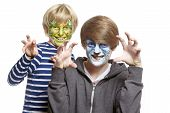 pic of growl  - Teenage and young boys with face painting monster and wolf growling on white background  - JPG