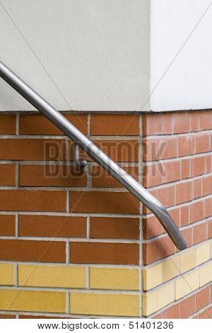 Detail Of An Hand Rail On A Brick-wall
