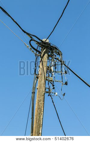 Old Wooden Power Line, Isolated On Blue Sky