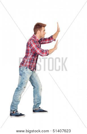 Young man with plaid shirt pushing isolated on white background