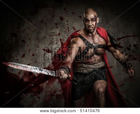 Wounded gladiator attacking with sword covered in blood