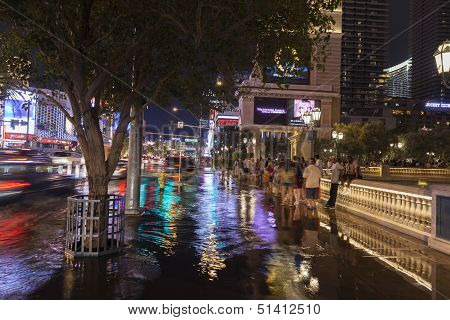 Tourists Stuck In A Storm On Las Vegas Boulevard In Las Vegas, Nv On July 19, 2013