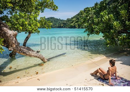 Beautiful Young Female Model Meditating And Relaxing, Looking At Turquoise Sea At Surin Tropical Isl