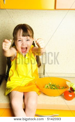 Excited Girl Making Salad