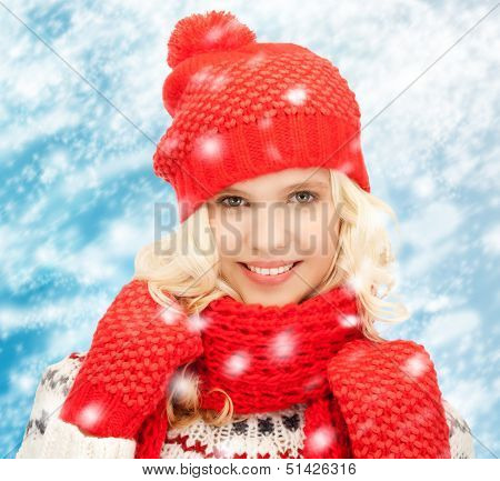winter, people, happiness concept - teenage girl in hat, muffler and mittens