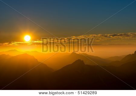 silhouette of several mountain peaks