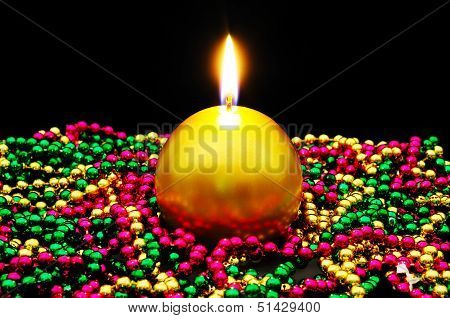 Gold candle with shiny beads.