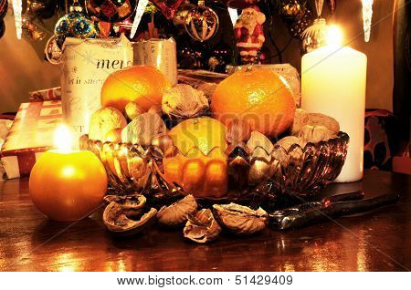 Mixed nuts and fruit with candles.
