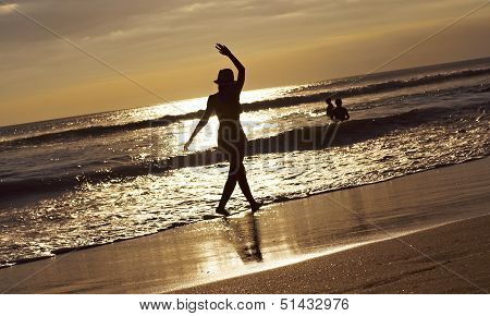 Silhouette of Young Woman On the Beach
