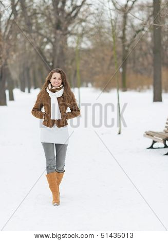 Smiling Young Woman Walking In Winter Park