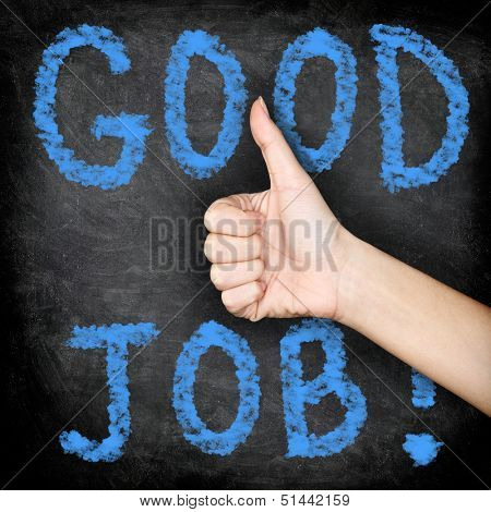 Good job - thumbs up blackboard concept. Close up of woman giving hand sign thumbs up of approval of job well done.