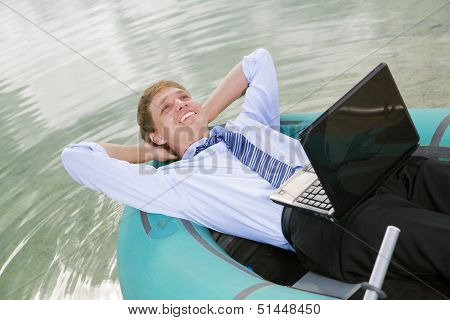 Satisfied Man Lay In Boat And Smile