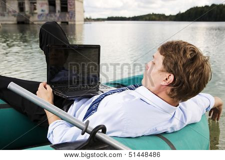 Man In Costume Lay Over Boat
