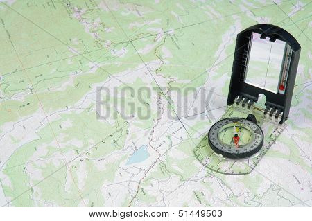 Topographical map with a a compass