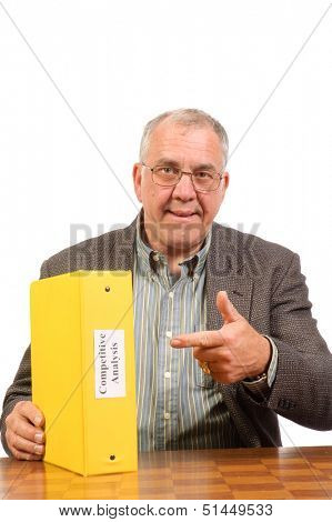 Baby-boomer businessman with competitive analysis report isolated on white
