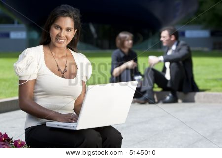 Beautiful Asian Woman On Laptop