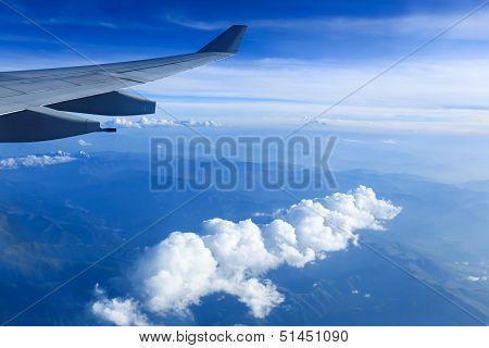 Plane Wing And Mountain Range