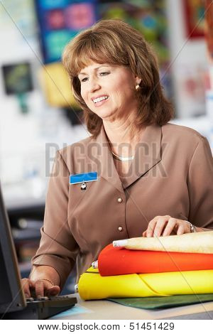 Female Cashier At Clothing Store
