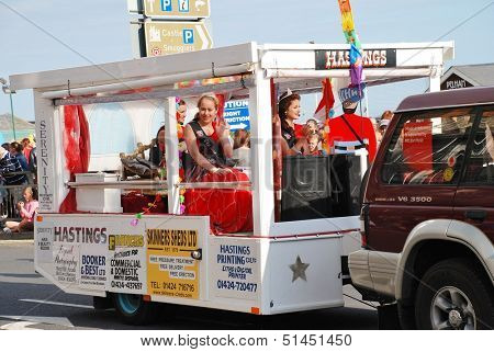 HASTINGS, ENGLAND - AUGUST 10: Miss Hastings,Bethany Hill (centre), takes part in the Old Town Carnival parade on August 10, 2013 in Hastings, East Sussex. The annual event was first held in 1968.