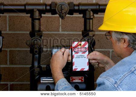 Man Applying Lockout Tag