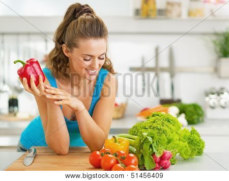 Portrait Of Happy Young Woman Ready To Make Fresh Vegetable Sala