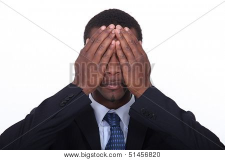 black man putting hands on his eyes