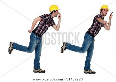 Twin tradesmen holding a walkie-talkie