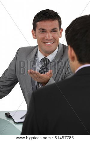 Businessman telling a joke to colleague