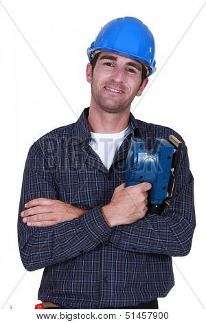 Man holding electric sander