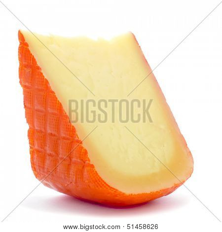 closeup of a piece of Mahon cheese from Spain, on a white background