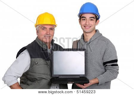 Tradesmen holding a laptop