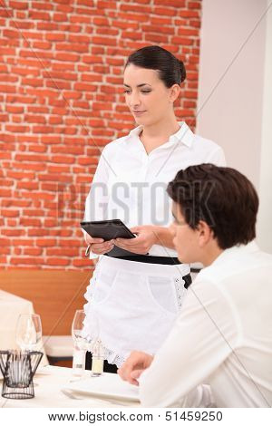 Waitress taking an order