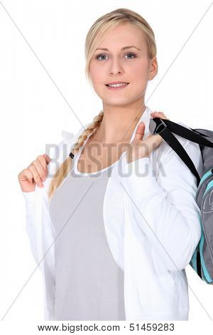 Blonde girl with sports bag