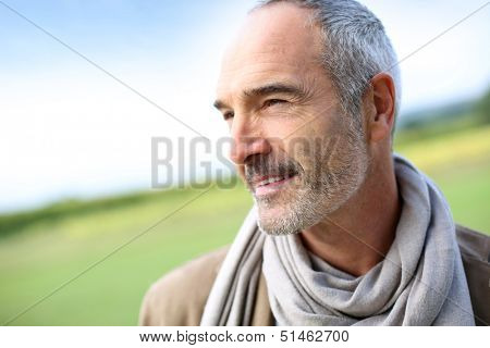Portrait of smiling mature handsome guy