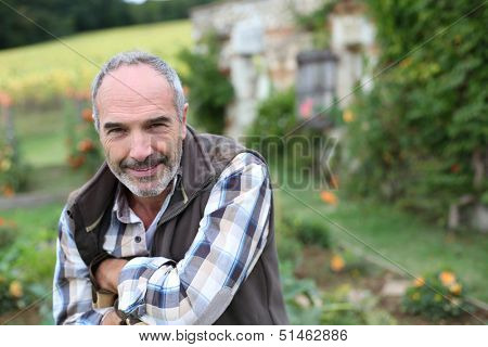 Portrait of senior gardener in vegetable garden