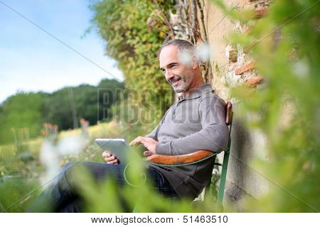 Man relaxing in country house on week-end