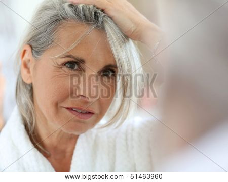 Senior woman worried by hair getting grey