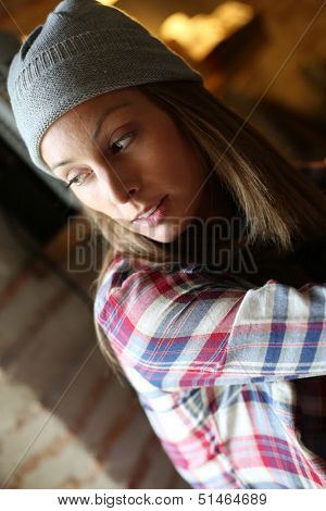Young trendy girl with lonesome expression