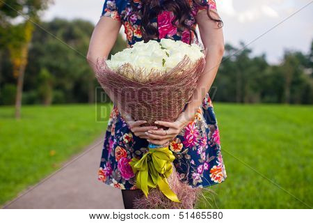 Incredibly Beautiful Large Bouquet Of White Roses At The Hands Of A Young Girl In Colored Dress