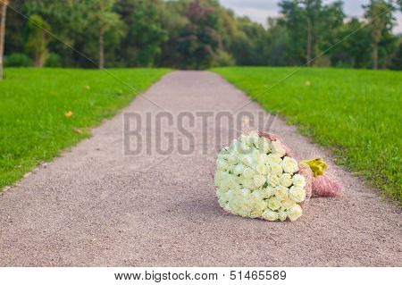 Incredibly Beautiful Large Bouquet Of White Roses On A Sandy Path In The Garden